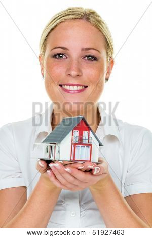 a young woman holds a model of a house in his hand. photo icon for the ownership of real estate. savings and home buying