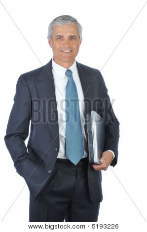 Middle Aged Businessman Carrying Laptop