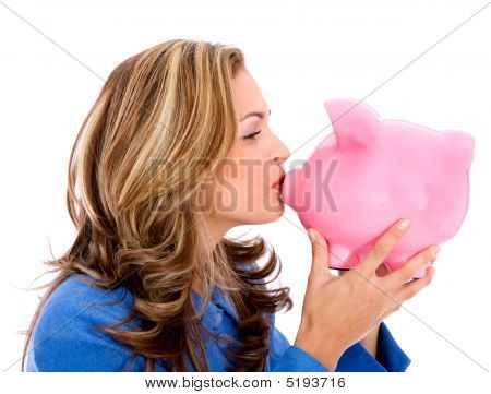 Business Woman And A Piggy Bank