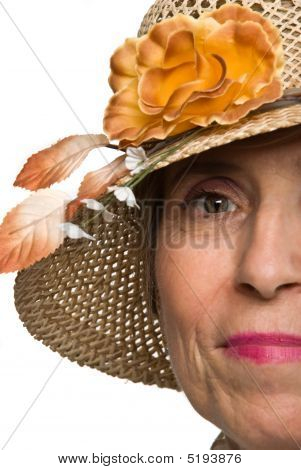 Half Face Senior Woman With Hat