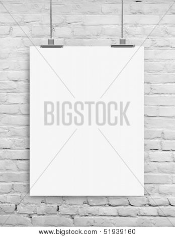 white paper on white grunge brick wall background