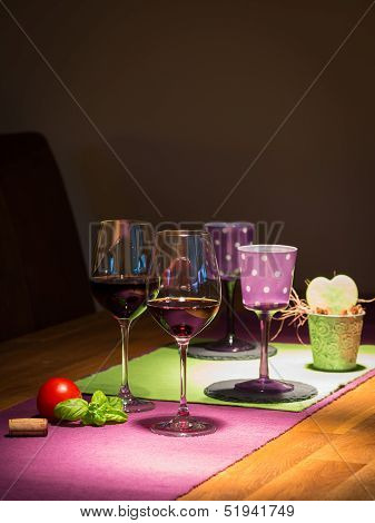 two filled red wine glasses