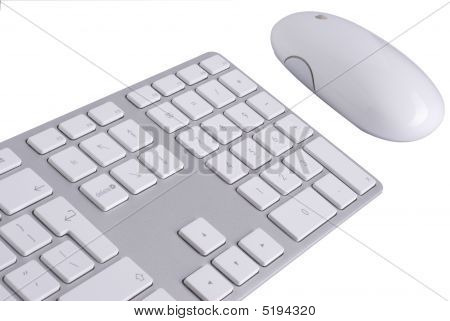 White Keyboard And Mouse Isolated Against White Background