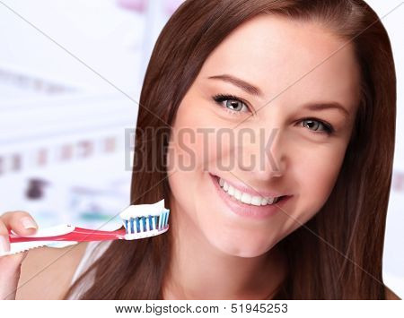 Closeup portrait of cute girl cleaning teeth at home, dental care, morning in bathroom, whiten toothpaste, freshness and beauty concept