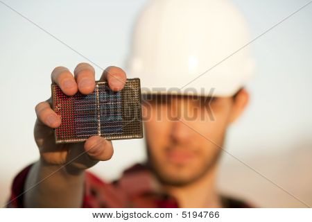 Handsome Young Man With Small Solar Panel
