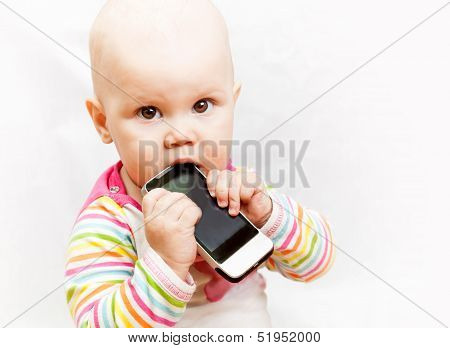 Little Baby Baby Chews On A Mobile Phone In Colorful Clothing