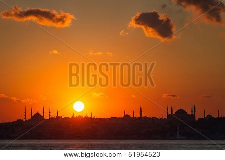 Istanbul silhouette. Blue Mosque and Hagia Sophia at sunset.