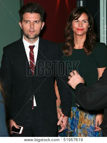 NEW YORK-OCT 3: Actor Adam Scott (L) and wife Naomi attend the premiere of 'A.C.O.D.' at the Landmark Sunshine Theater on October 3, 2013 in New York City.