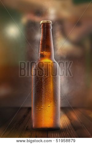 Cold beer bottle with drops, frost and vapour