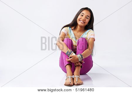 Young cute latin american girl smiling isolated on white background