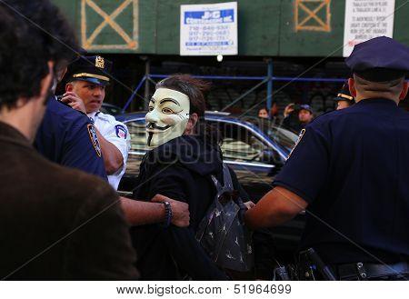Mask wearing marcher arrested