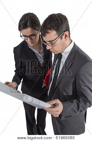 Couple Of Architects Revising A House Project On White Background