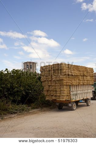 Bales Of Hay On The Tractor