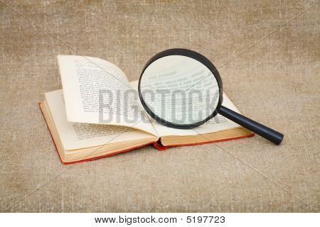 Still-life From A Magnifier And Book