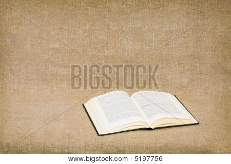 Opened Book On Canvas Background