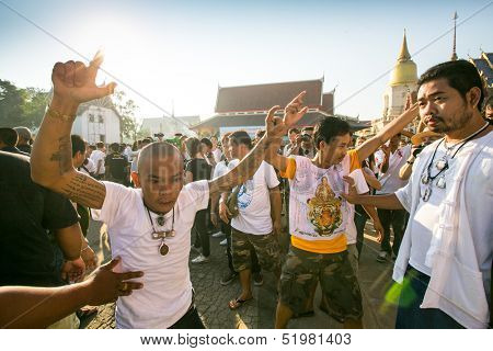 NAKHON CHAI, THAILAND - MAR 23: Unidentified participant Master Day Ceremony able Khong Khuen - spirit possession during the Wai Kroo at Wat Bang Pra on Mar 23, 2013 in Nakhon Chai, Thailand.