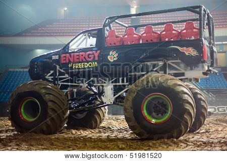 MOSCOW - MAR 23: Big car on the sand and empty stands on Show Monster Mania in Olimpiyskiy in March 23, 2013 in Moscow, Russia.