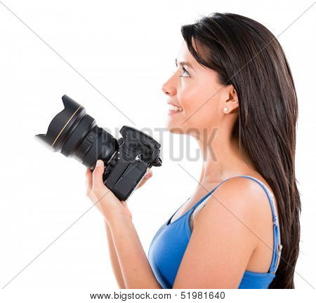 Woman holding a camera - isolated over a white background