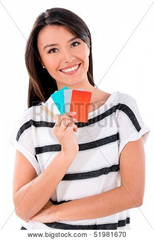 Woman holding credit cards - isolated over a white background