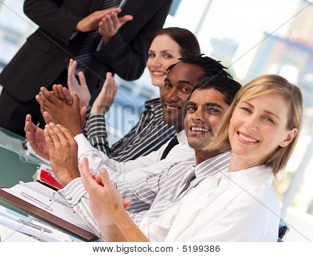 Business People Applauding After A Presentation