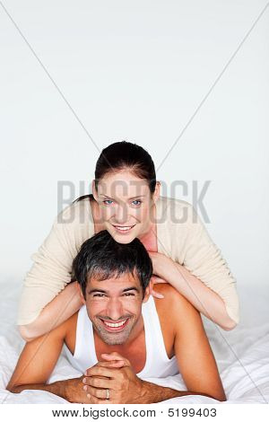 Happy Couple In Bed With Copyspace
