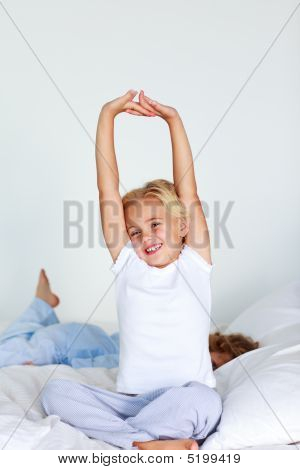 Beautiful Daughter Stretching After Sleeping