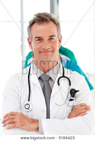 Senior Doctor With Folded Arms