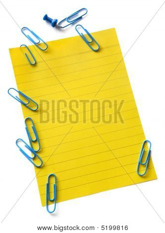 Yellow Notepaper With Paperclips