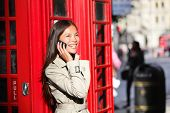 picture of phone-booth  - London business woman on smart phone by red phone booth - JPG