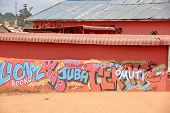 Graffiti On A Bright Orange Wall in Africa