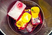 stock photo of bio-hazard  - Danger medical waste disposed in a garbage box - JPG