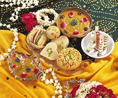stock photo of mithai  - Delicious, fresh and unique verity of Asian mithai & jewelry  on ground