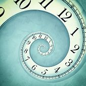 stock photo of hypnotizing  - Old blue clock in the drost effect - JPG