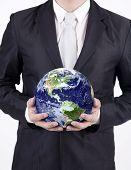 foto of courtesy  - Businessman holding a globe isolated over white background - JPG