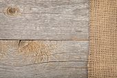 image of sackcloth  - Burlap texture on wooden table background - JPG