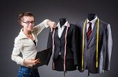 stock photo of tailoring  - Woman tailor working on clothing - JPG