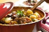 image of stew pot  - Traditional goulash or beef stew in red crock pot ready to serve - JPG
