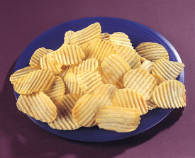 stock photo of doritos  - Fresh and salty crinkle chips in plate - JPG