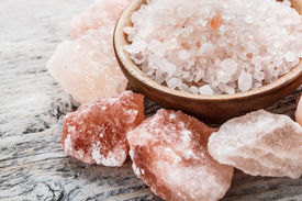 stock photo of crystal salt  - Himalayan pink crystal salt close up shot - JPG