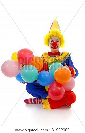 Child Dressed As Colorful Funny Clown With Balloons