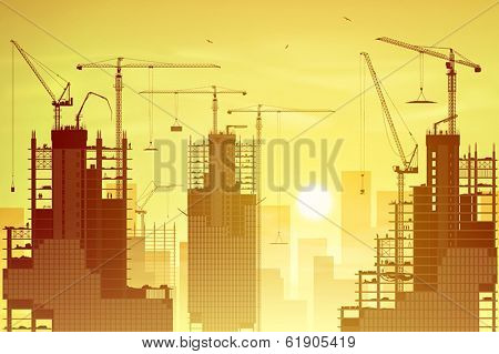 A Construction Site with Lots of Tower Cranes and Sunset, Sunrise