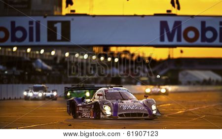 Sebring, FL - Mar 13, 2014:  The Michael Shank Ford EcoBoost Need For Speed car races through the turns at the 12 Hours of Sebring at Sebring International Raceway in Sebring, FL.