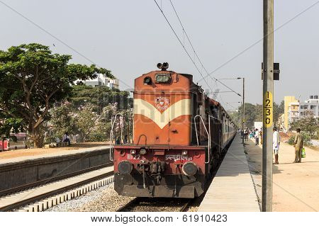 Indian railways - passenger awaiting for the train to halt to board the train