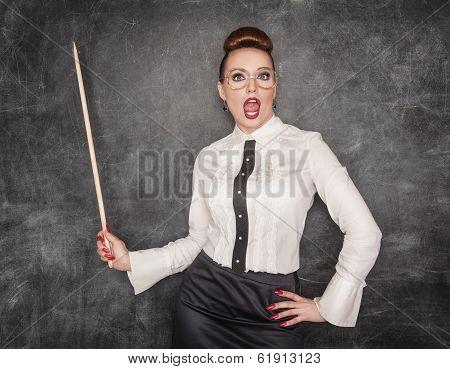 Surprised Teacher With Wooden Pointer