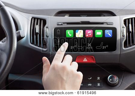 Man Sitting In A Car And Touching Play Finger In A Auto Smart System