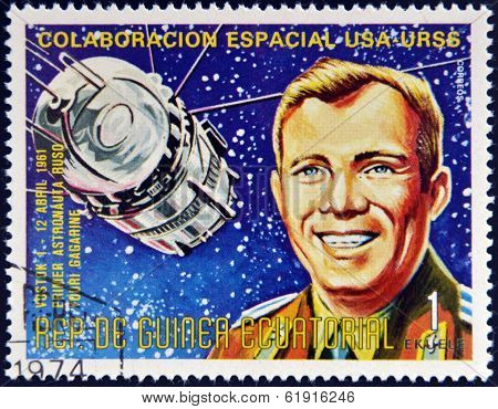 A stamp printed in Guinea shows Vostok1 and Yuri Gagarin Apollo-Soyuz Space Project