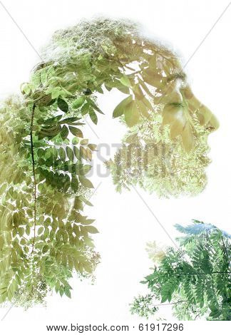 Portrait of beautiful woman combined with photograph of nature in trendy double exposure technique.