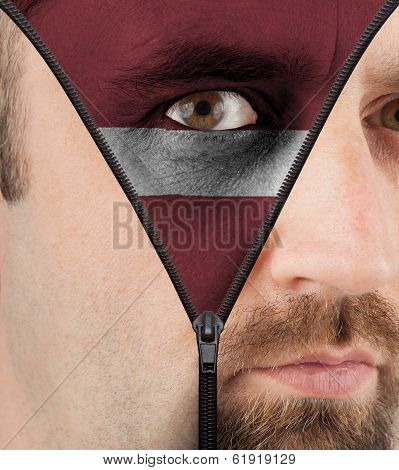 Unzipping Face To Flag Of Latvia