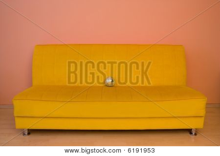 Yellow Sofa With Small Discoball