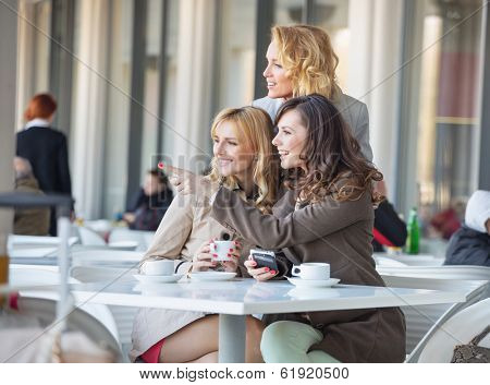 Group of young women drinking coffee